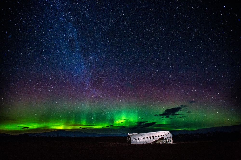 Auroras and DC-3 in the South of Iceland Photograph by Carlos Gauna